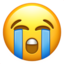 Emoji de cara llorando en Apple, iOS